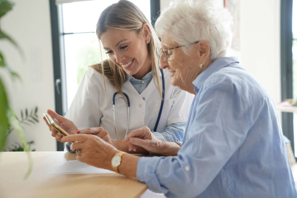 home health nurse taking care of a patient