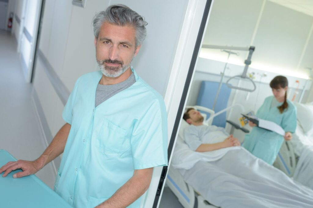 male nurse working in post anesthesia care unit